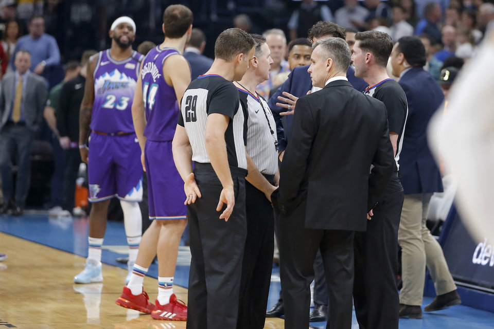 Photo - Oklahoma City coach Billy Donovan meets with officials before an NBA basketball game between the Oklahoma City Thunder and the Utah Jazz was postponed at Chesapeake Energy Arena in Oklahoma City, Wednesday, March 11, 2020. [Bryan Terry/The Oklahoman]
