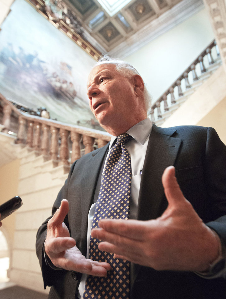 Photo - Sen. Ben Cardin, D-Md., one of the House and Senate conferees, leaves the Senate on Friday on Capitol Hill in Washington. AP Photo