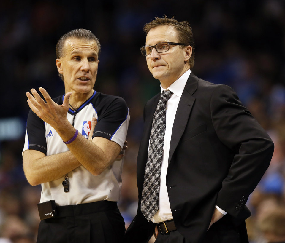 Photo - Referee Ken Mauer (41) talks to Oklahoma City coach Scott Brooks during an NBA basketball game between the Oklahoma City Thunder and the Dallas Mavericks at Chesapeake Energy Arena in Oklahoma City, Sunday, March 16, 2014. Dallas won, 109-86. Photo by Nate Billings, The Oklahoman