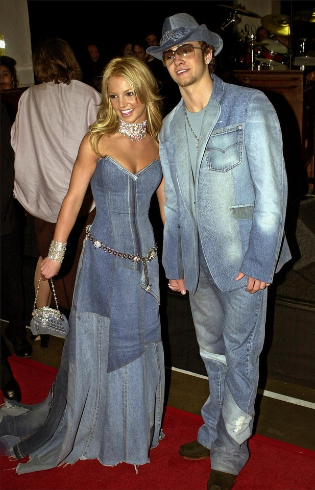 "FILE - In this Jan. 8, 2001 file photo, show host Britney Spears, left, and Justin Timberlake of N'Sync arrive at the 28th Annual American Music Awards in Los Angeles. ""Mad Men"" star Jon Hamm is going mad over Justin Timberlake's suit and tie, the song and the singer's style. As for Timberlake, Hamm believes the pop star has ""always been a very fashion forward kind of guy,"" except his all denim ensemble shown here that he wore to the 2001 American Music Awards. (AP Photo/Mark J. Terrill, File)"