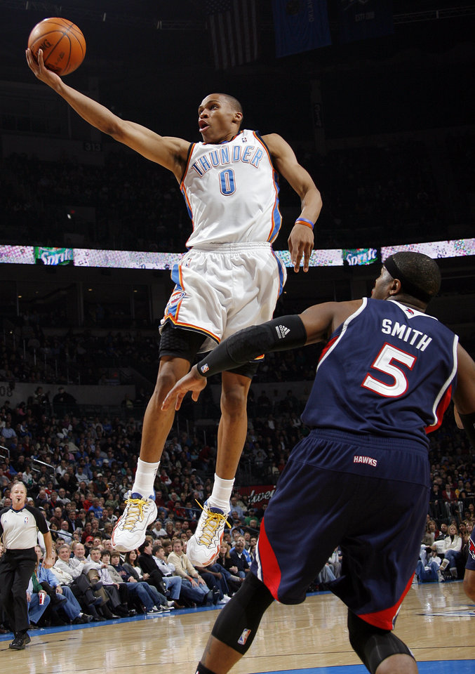 Oklahoma City's Russell Westbrook (0) shoots past Josh Smith (5) of Atlanta during the NBA basketball game between the Atlanta Hawks and the Oklahoma City Thunder at the Ford Center in Oklahoma City, Tuesday, February 2, 2010. Photo by Nate Billings, The Oklahoman