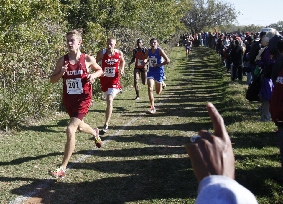 Cleveland's Baylor Harvey takes an early lead during the Boys 4A State Cross Country Finals at Edmond Santa Fe High School in Edmond, OK, Saturday, October 27, 2012. He went on to win the event.  By Paul Hellstern, The Oklahoman