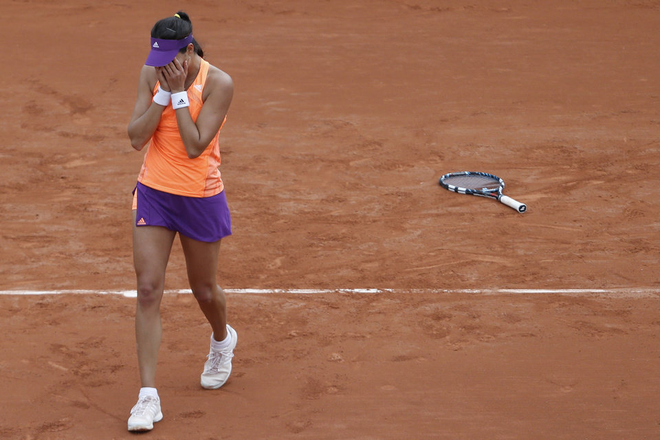 Photo - Spain's Garbine Muguruza celebrates winning the second round match of the French Open tennis tournament defeating Serena Williams of the U.S. in two sets 6-2, 6-2, at the Roland Garros stadium, in Paris, France, Wednesday, May 28, 2014. (AP Photo/Darko Vojinovic)