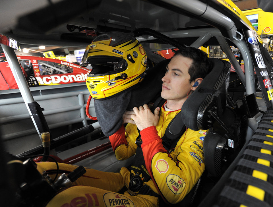 Photo - Sprint Cup driver Joey Logano prepares to go on the track during the first round of practice for a NASCAR auto race at Martinsville Speedway in Martinsville, Va., Friday March 28, 2014. (AP Photo/Mike McCarn)