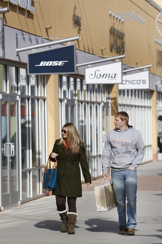 Megan Lamerton and her brother Joe Lamerton do some last minute shopping  at The Outlet Shoppes in Oklahoma City, Monday December 24, 2012. Photo By Steve Gooch, The Oklahoman