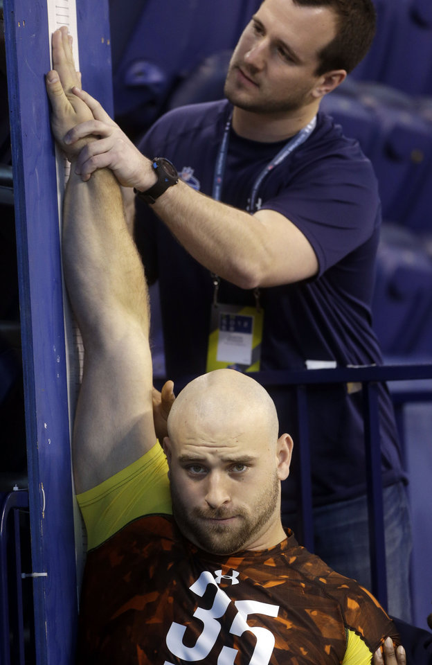 Oregon offensive lineman Kyle Long gets measured during the NFL football scouting combine in Indianapolis, Ind., Saturday, Feb. 23, 2013. (AP Photo/Dave Martin)