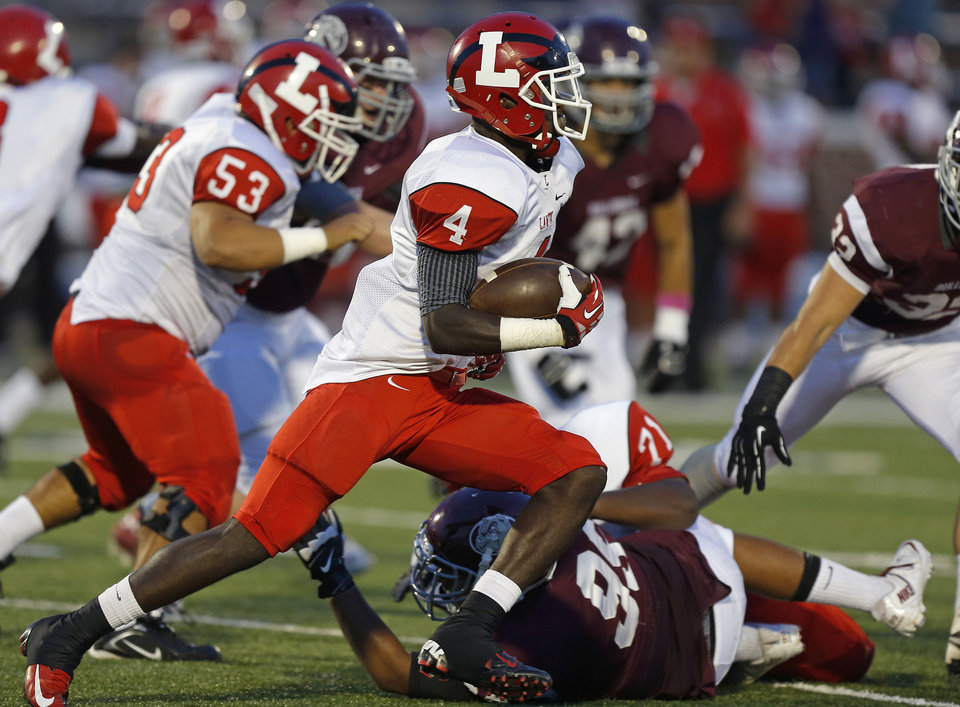 Lawton's Michael Warren runs against Edmond Memorial during their high school football game at Wantland Stadium in Edmond, Okla., Friday, Sept. 27, 2013. Photo by Bryan Terry, The Oklahoman