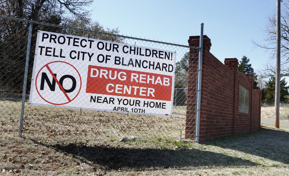 Photo - Top:  A protest sign is posted on a fence about a mile from Second Story Ranch .   Signs, posted around the area, remind residents of a planning commission meeting in Blanchard on Thursday.  Photos by Steve Sisney,  The Oklahoman  STEVE SISNEY -