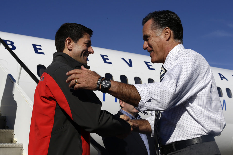 Republican presidential candidate, former Massachusetts Gov. Mitt Romney greets his vice presidential running mate, Rep. Paul Ryan, R-Wis., at Port Columbus International Airport in Columbus, Ohio, Friday, Oct. 12, 2012. (AP Photo/Charles Dharapak)