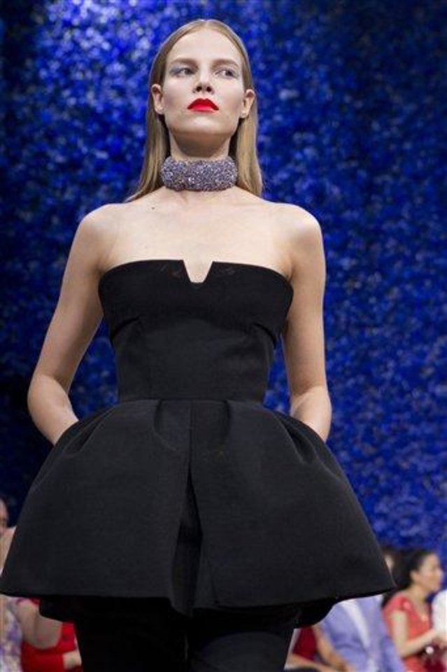 Photo - A model wears a creation by fashion designer Ralf Simons for Dior's Haute Couture Fall-Winter 2013 collection presented in Paris, Monday July 2, 2012. (AP Photo/Jacques Brinon)