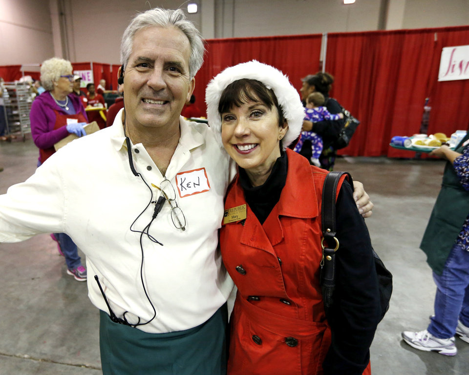 Photo -  Red Andrews Christmas Dinner's Ken Cassil and board member Mary Blankenship Pointer pose at Cox Convention Center. Cassil is the grand nephew of Red Andrews. [Photo by Steve Sisney, The Oklahoman]