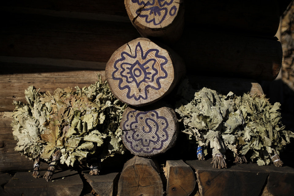 Photo - Dried herbs sit in the sun outside a steam sauna at the British Banya bathhouse, Saturday, Feb. 15, 2014, in Krasnaya Polyana, Russia, just a few miles away from the ski slopes where athletes are competing for Olympic medals. (AP Photo/Jae C. Hong)