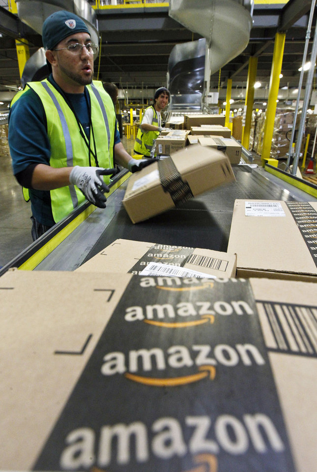 "On ""Cyber Monday,"" Nicholas Lerma gets packages ready for shipping at the Amazon.com fulfillment center in Phoenix. Americans clicked away on their computers and smartphones for deals on Cyber Monday, which is expected to be the biggest online shopping day in history. AP Photo <strong>Ross D. Franklin</strong>"