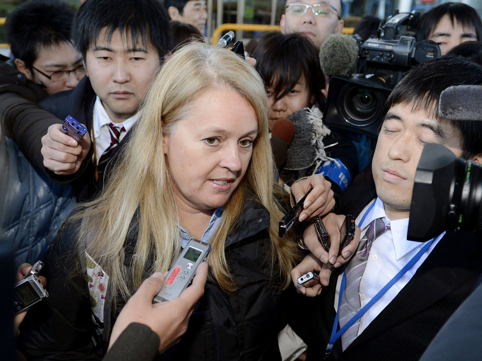 A representative of the U.S. investigation team is surrounded by the reporters as they arrived at Takamatsu airport,  following an emergency landing of a Boeing 787 exposed a battery fire risk in Takamatsu, western Japan, Friday, Jan. 18, 2013.  Boeing, the U.S. National Transportation Safety Board and Federal Aviation Administration were sending representatives to work with the Japanese government on the investigation, NTSB spokeswoman Kelly Nantel said. (AP Photo/Kyodo News)  JAPAN OUT, MANDATORY CREDIT, NO LICENSING IN CHINA, HONG KONG, JAPAN, SOUTH KOREA AND FRANCE