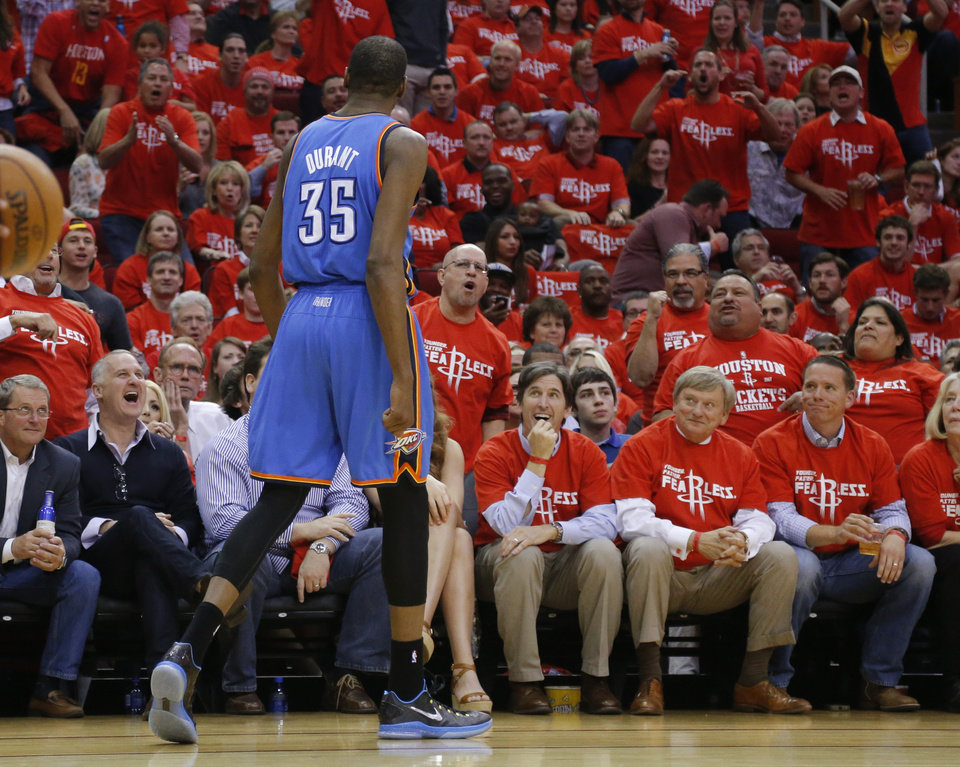 Photo - The cord shouts a Oklahoma City's Kevin Durant (35) during Game 6 in the first round of the NBA playoffs between the Oklahoma City Thunder and the Houston Rockets at the Toyota Center in Houston, Texas, Friday, May 3, 2013. Oklahoma City won 103-94. Photo by Bryan Terry, The Oklahoman