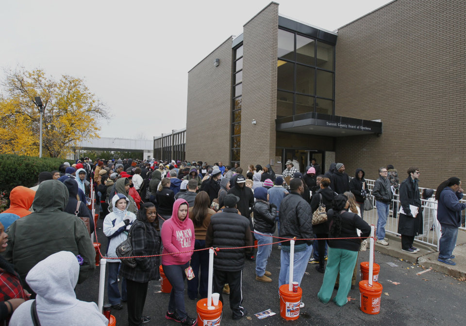 Photo -   Voters wait hours in long lines to cast their early vote at the Summit County Board of Elections on Monday, Nov. 5, 2012, in Akron, Ohio. About 30 million people have already voted in 34 states and the District of Columbia, either by mail or in person. (AP Photo/Akron Beacon Journal, Paul Tople)