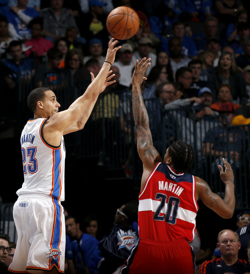 Oklahoma City\'s Kevin Martin (23) shoots a basket over Washington\'s Cartier Martin (20) during an NBA basketball game between the Oklahoma City Thunder and the Washington Wizards at Chesapeake Energy Arena in Oklahoma City, Wednesday, March 19, 2013. Oklahoma City won 103-80. Photo by Bryan Terry, The Oklahoman
