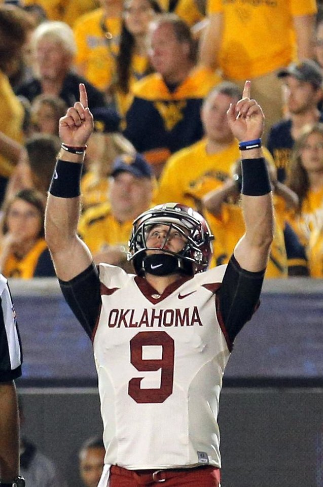 Photo - Oklahoma's Trevor Knight (9) celebrates a touchdown in the fourth quarter during the college football game between West Virginia  Mountaineers and the University of Oklahoma Sooners at Milan Puskar Stadium in Morgantown, W.Va., Saturday, Sept. 20, 2014. Photo by Sarah Phipps, The Oklahoman