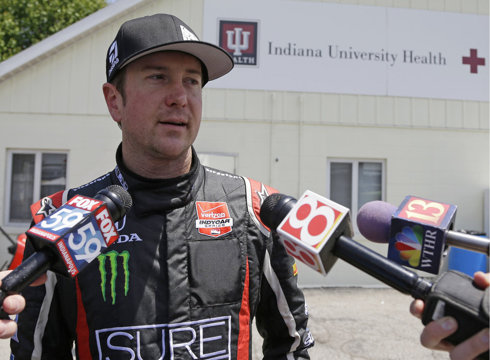 Photo - Kurt Busch is interviewed as he leaves the track medical center after he crashed in the second turn during practice for the Indianapolis 500 IndyCar auto race at the Indianapolis Motor Speedway in Indianapolis, Monday, May 19, 2014. (AP Photo/Michael Conroy)