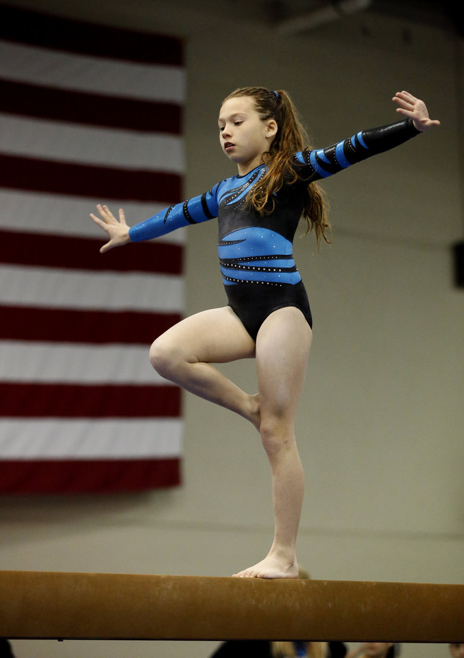 Photo - Laney Wilson, 9, with Hopes and Dreams Gymnastics in Springdale, Ark. warms up on the balance beam during the Nadia Comaneci Invitational Sports Festival on Saturday, Feb. 16, 2013  in Oklahoma City, Okla. Photo by Steve Sisney, The Oklahoman
