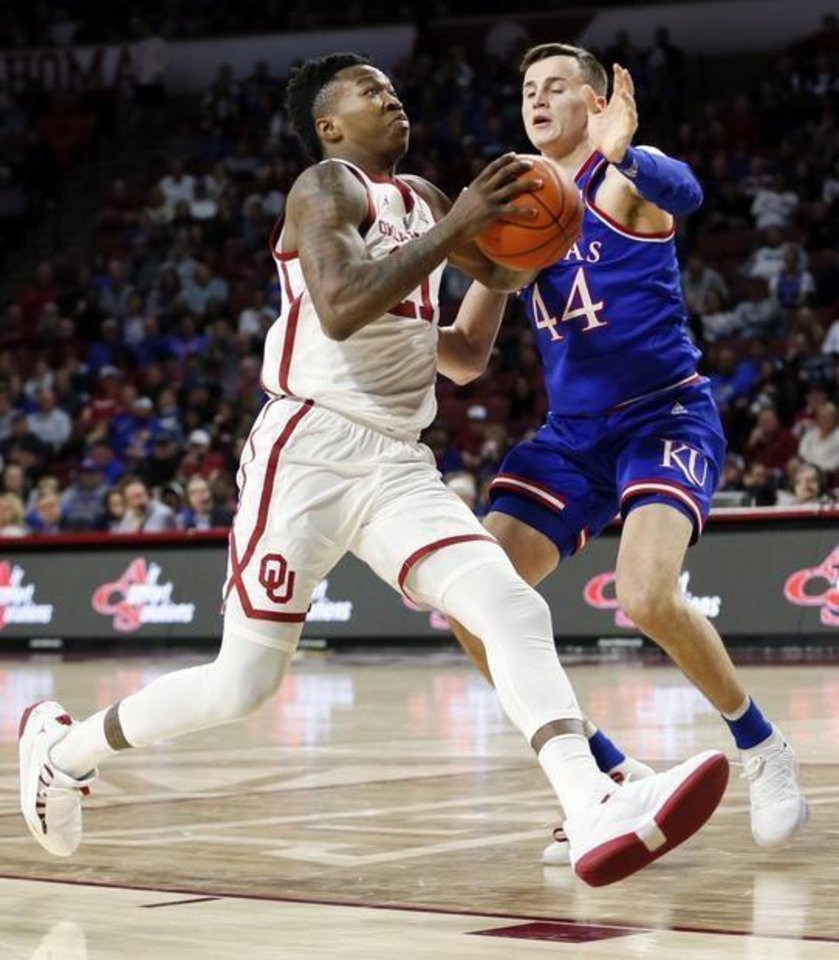 "Photo -  Oklahoma's Kristian Doolittle, left, chooses his words with deliberate sincerity, and when contemplating what he learned about himself this season, ""resilience"" was an appropriate choice.  [AP PHOTO]"