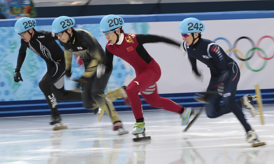Photo - From left, J.R. Celski of the United States, Satoshi Sakashita of Japan, Han Tianyu of China, and Park Se-Yeong of South Korea start in a men's 500m short track speedskating quarterfinal at the Iceberg Skating Palace during the 2014 Winter Olympics, Friday, Feb. 21, 2014, in Sochi, Russia. (AP Photo/Ivan Sekretarev)
