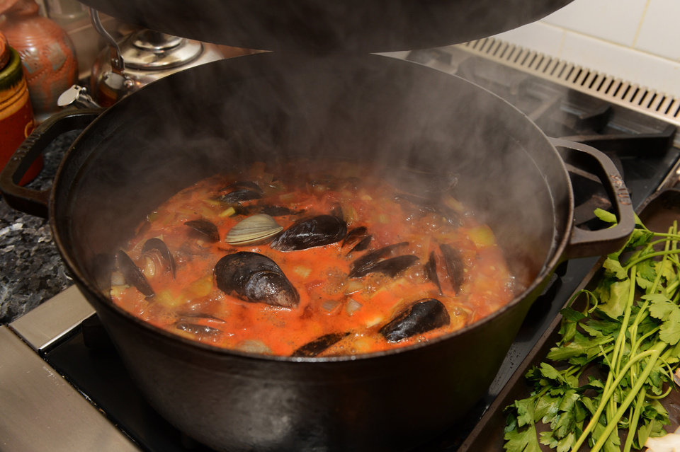 Photo - Steam rises from a pot of Italian Fish Soup as it cooks on a stove. (Johnny Crawford/Atlanta Journal-Constitution/MCT)