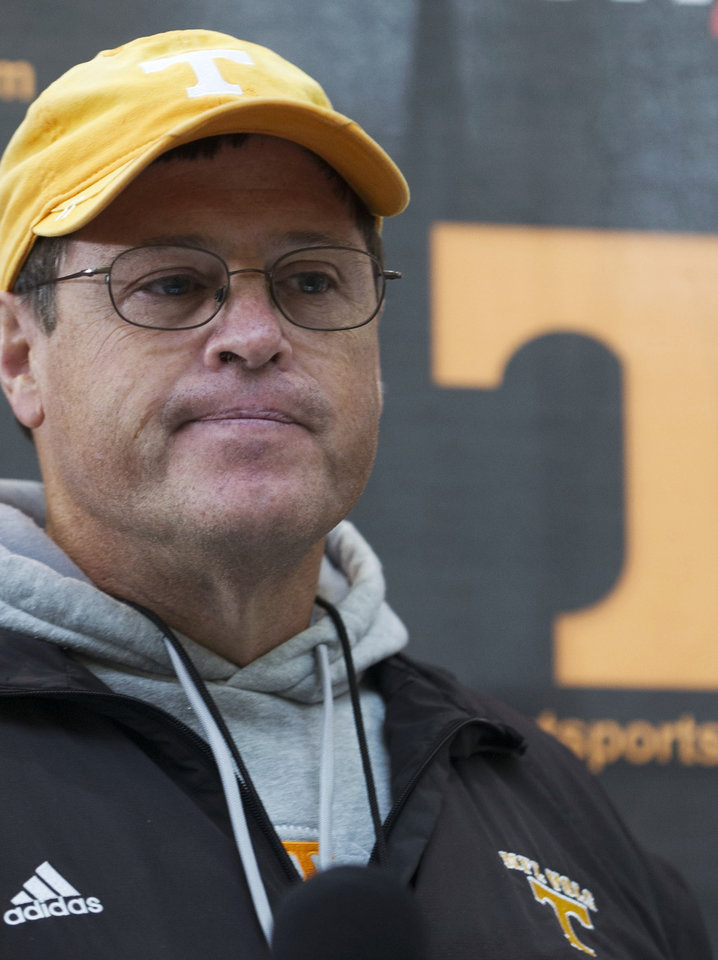 Photo -   Tennessee interim football coach Jim Chaney talks with reporters after practice in Knoxville, Tenn., on Monday, Nov. 19, 2012. Chaney, the team's offensive coordinator, was named interim coach after Derek Dooley was fired as coach on Sunday. (AP Photo/Knoxville News Sentinel, J. Miles Cary)