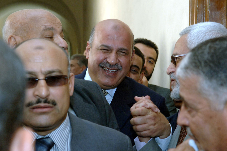 Photo - FILE - In this Thursday, May 18, 2006 file photo, then a pro-reform Egyptian judge Mahmoud Mekki, center, enters a disciplinary hearing in Cairo at the Egyptian Supreme Court. Egypt's state TV says Vice President Mahmoud Mekki has resigned. Mekki's Saturday, Dec. 22, 2012 resignation was announced with more than five hours to go of voting in the second and final phase of a referendum on a disputed, Islamist-backed constitution. (AP Photo, File)