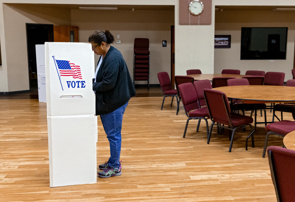 Photo - Voter Dianah Dillon fills out her ballot while voting at International Pentecostal Assembly in Yukon, Okla. on Tuesday, March 3, 2020.    [Chris Landsberger/The Oklahoman]