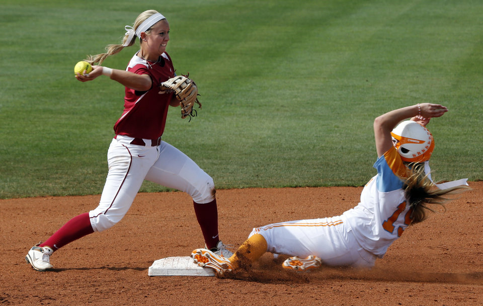 Photo - Oklahoma's Javen Henson gets the first half of a double play forcing out Tennessee's Lexi Overstreet as the University of Oklahoma Sooner (OU) softball team plays Tennessee in game two of the NCAA super regional at Marita Hynes Field on May 24, 2014 in Norman, Okla. Photo by Steve Sisney, The Oklahoman