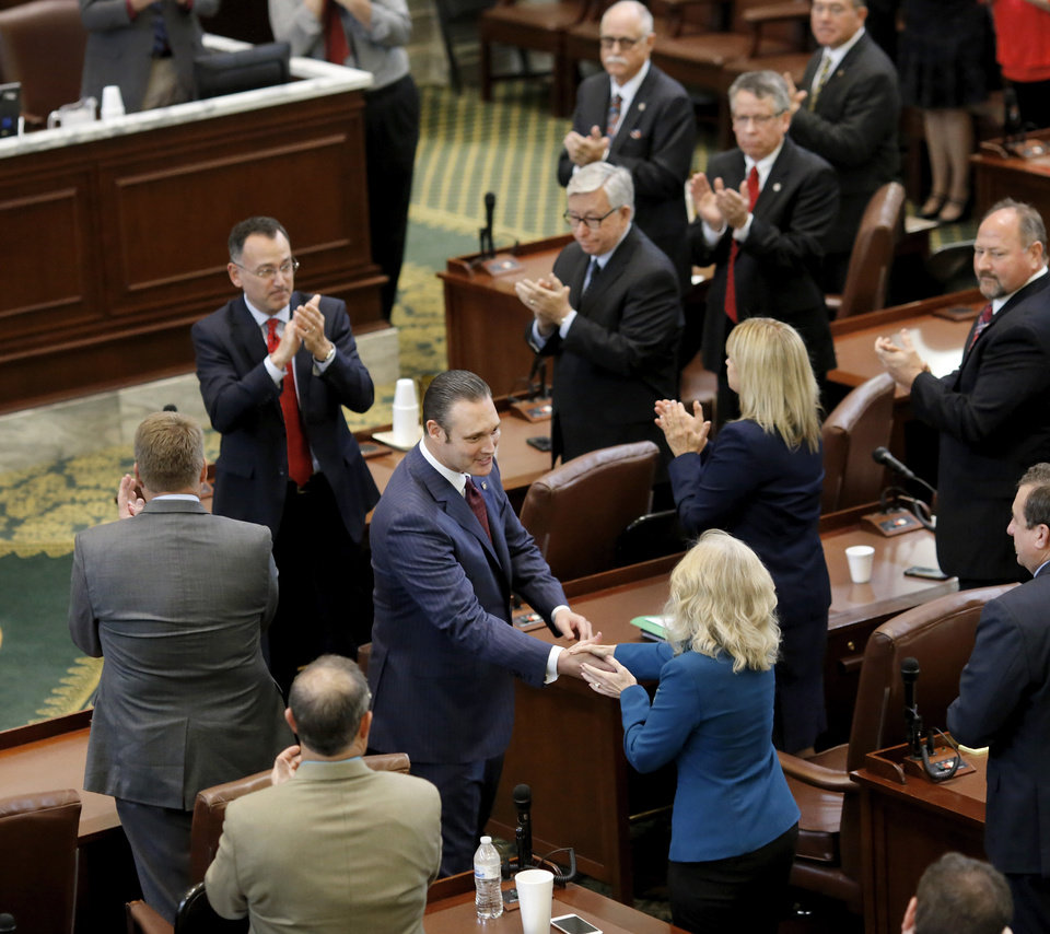 Photo -  Oklahoma House Speaker Charles McCall, R-Atoka, center, accepts congratulations and is applauded by lawmakers after being elected to the top post in the House by his legislative colleagues. State representatives meet for an organizational day in the House chamber on Tuesday, Jan. 3, 2017. Initial discussion focused on the resignation/non-resignation of Rep. Dan Kirby, Tulsa, who has been accused of sexual harassment with a former staff member. [Photo by Jim Beckel, The Oklahoman]