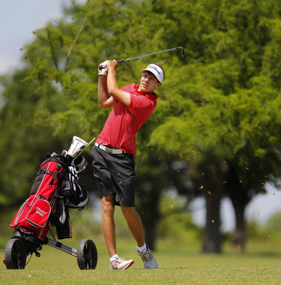 Photo - Grant Sikes, Hilldale, sends his ball toward the green. Class 4A boys state golf tournament at Lake Hefner North Golf Course in Oklahoma City on Monday, May 9. Photo by Jim Beckel, The Oklahoman.