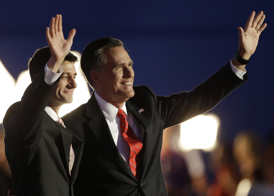 Photo -   Republican presidential nominee Mitt Romney and Republican vice presidential nominee, Rep. Paul Ryan, left, wave following Romney's speech during the Republican National Convention in Tampa, Fla., on Thursday, Aug. 30, 2012. (AP Photo/Charlie Neibergall)