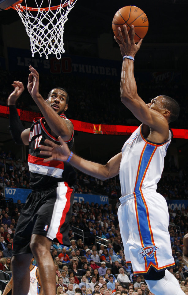 Oklahoma City's Russell Westbrook (0) takes a shot as LaMarcus Aldridge (12) of Portland defends in the first half during the NBA basketball game between the Oklahoma City Thunder and Portland Trail Blazers at Chesapeake Energy Arena in Oklahoma City, Tuesday, Jan. 3, 2012. Photo by Nate Billings, The Oklahoman