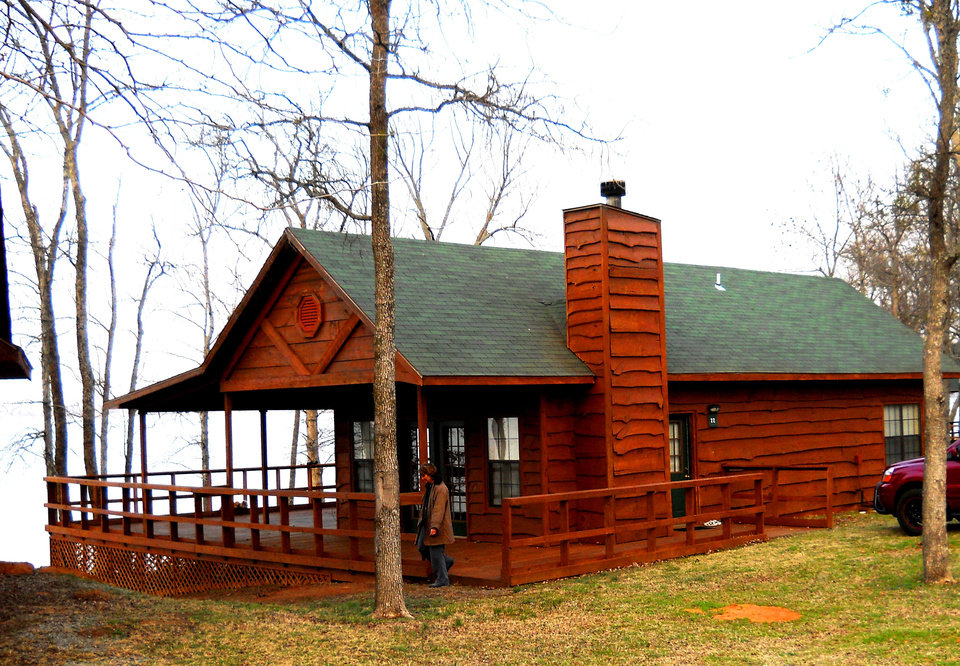 Photo - A cabin at Hugo Lake State Park overlooks the lake. PHOTO PROVIDED