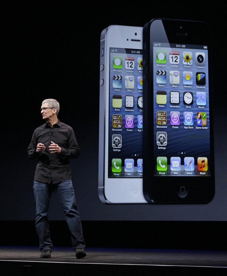 Photo - Apple CEO Tim Cook talks on stage Wednesday during the introduction of the new iPhone 5 in San Francisco. AP Photo
