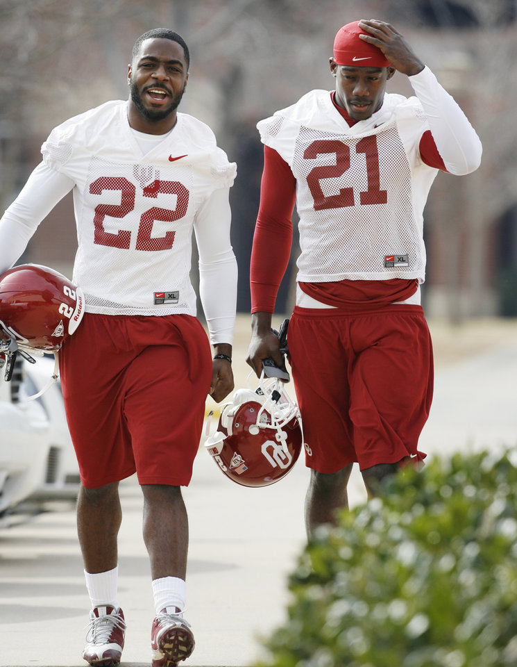 Photo - Keenan Clayton (22) and J.R. Bryant (21) walk to University of Oklahoma (OU) spring football practice in Norman, Oklahoma, on Tuesday, March 3, 2009.   