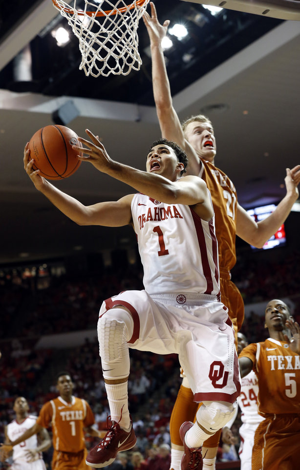 Photo - Oklahoma Sooner Frank Booker (1) shoots under the arms of Lammert Connor as the University of Oklahoma Sooners (OU) men play the Texas Longhorns (TU) in NCAA, college basketball at The Lloyd Noble Center on Saturday, March 1, 2014  in Norman, Okla. Photo by Steve Sisney, The Oklahoman