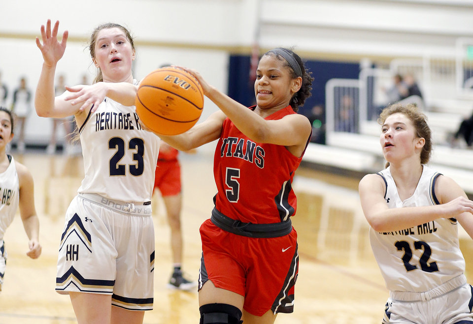 Photo - Carl Albert's Azya Poole tries to get a loose ball as Heritage Hall's Avery Freeman (23) and Lucille Sullivan (22) defend during the high school girls game between Heritage Hall and  Carl Albert at Heritage Hall in Oklahoma City, Friday, Jan. 17, 2020.  [Sarah Phipps/The Oklahoman]