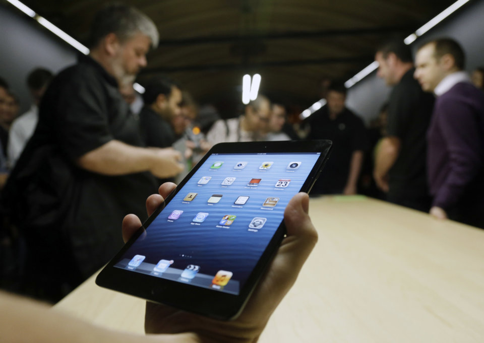 Photo -   The iPad Mini is shown in San Jose, Calif., Tuesday, Oct. 23, 2012. Apple Inc. is refusing to compete on price with its rivals in the tablet market, it's pricing its new, smaller iPad well above the competition. On Tuesday, the company revealed the iPad Mini, with a screen that's about two-thirds the size of the full-size model, and said it will cost $329 and up. (AP Photo/Marcio Jose Sanchez, File)