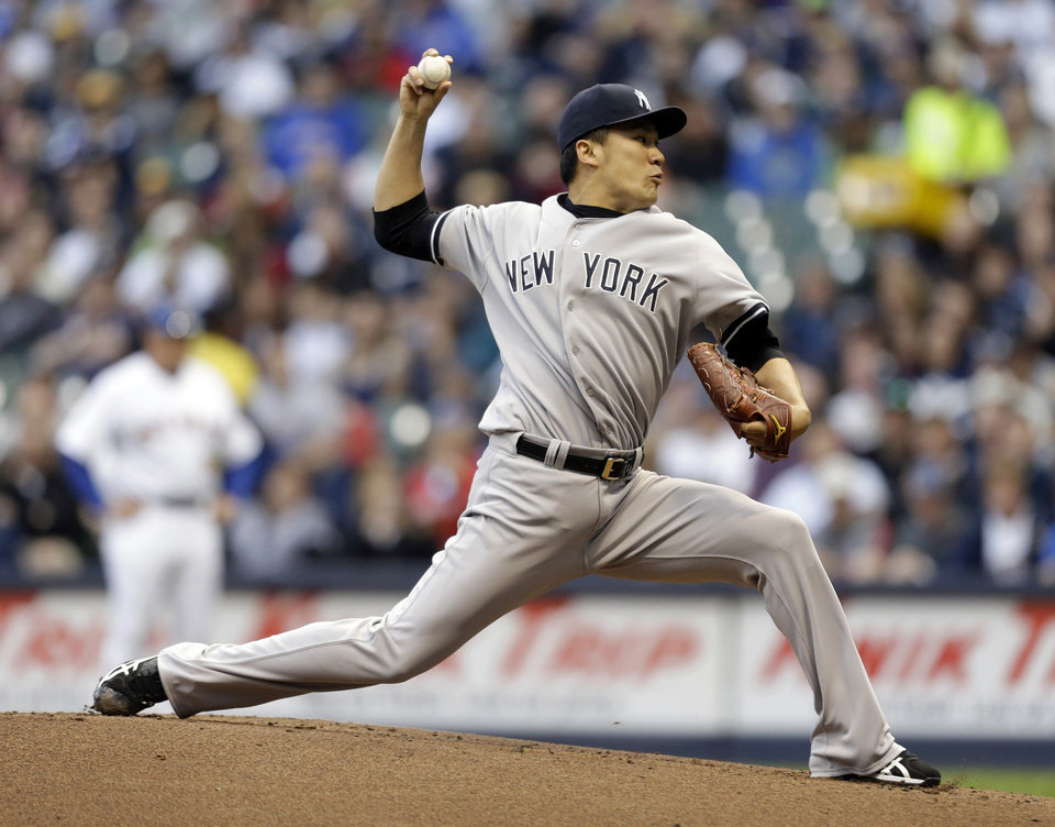 Photo - New York Yankees starting pitcher Masahiro Tanaka throws to the Milwaukee Brewers in the first inning of a baseball game Friday, May 9, 2014, in Milwaukee. (AP Photo/Jeffrey Phelps)
