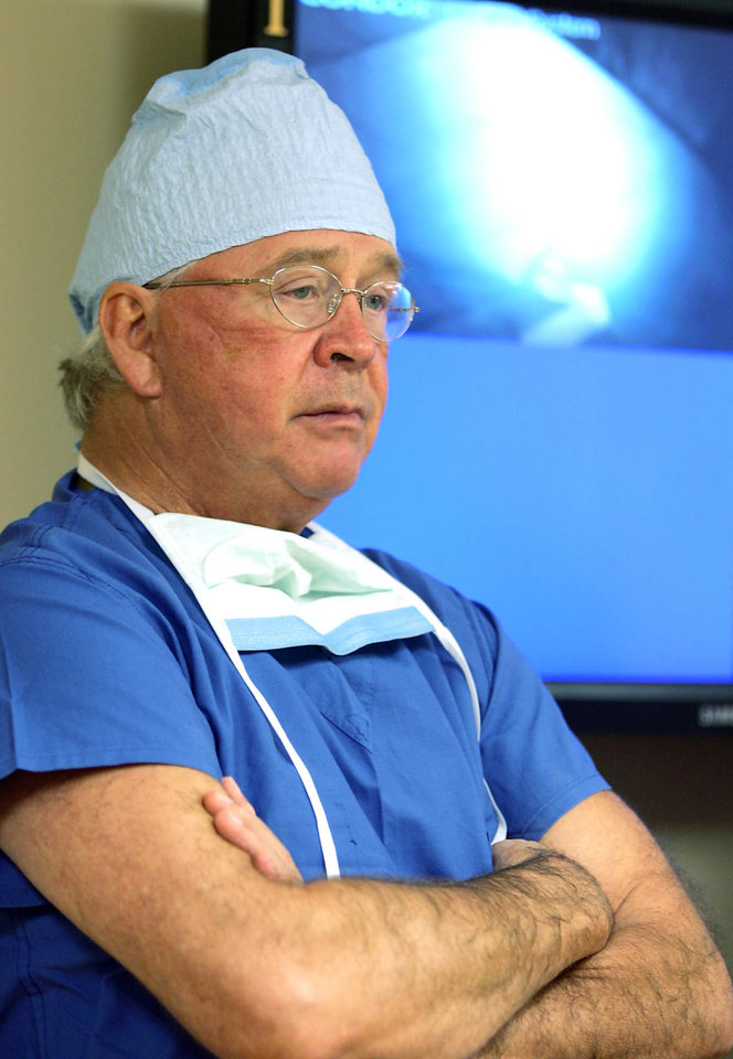 Photo - FILE- In this Aug. 24, 2007, file photo,  Dr. James Andrews waits between surgeries at the Andrews Institute for Orthopedics and Sports Medicine in Gulf Breeze, Fla. Tommy John surgery has increased 10-fold in the first decade of the 21st century, Dr. Andrews, one of the world's top orthopedic doctors, and and Dr., Jeremy Bruce wrote in the May issue of the Journal of the American Academy of Orthopaedic Surgeons, citing a paper published by J.R. Dugas in 2010. Dr. Andrews will be meeting with a research committee on Monday at Major League Baseball's headquarters. (AP Photo/Mari Darr-Welch, File)