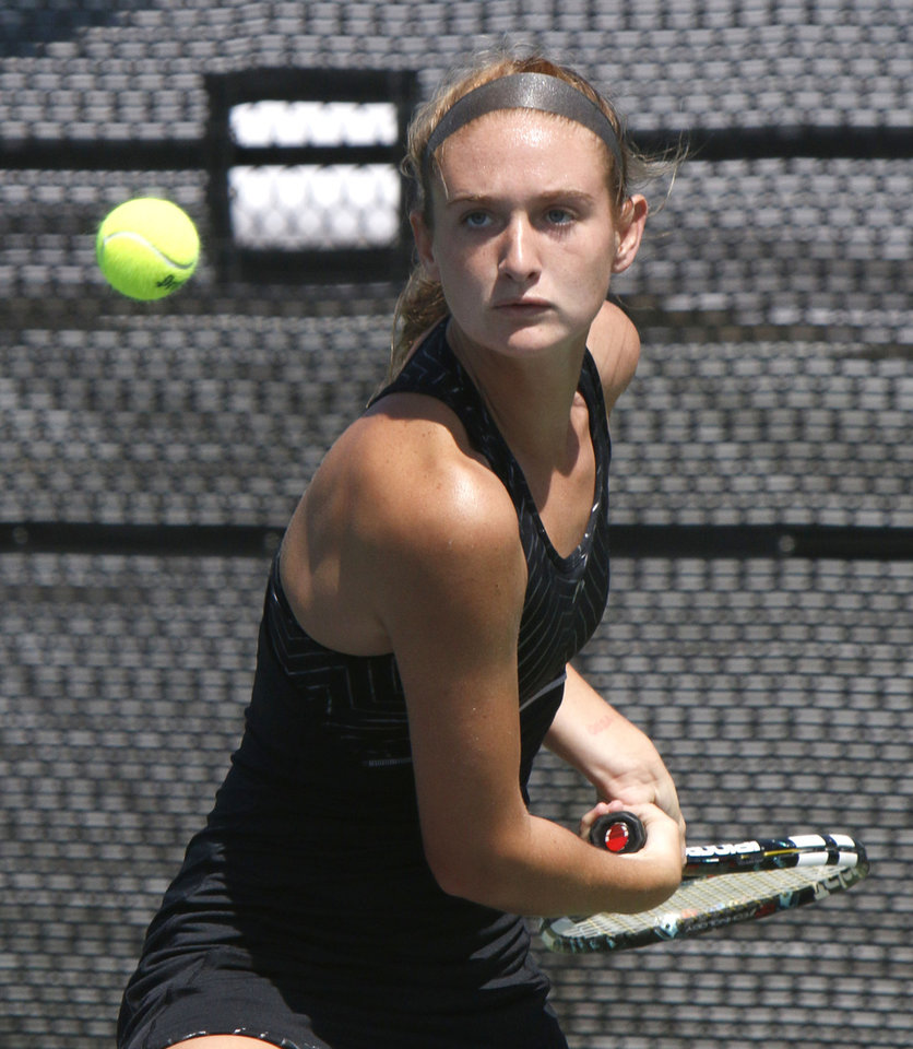 Photo - Carl Albert's Sara Lankford plays against Western Heights' Tresa Nguyen during the 5A Girl's state tennis tournament at the OKC Tennis Center in Oklahoma City, OK, Friday, May 9, 2014,  Photo by Paul Hellstern, The Oklahoman