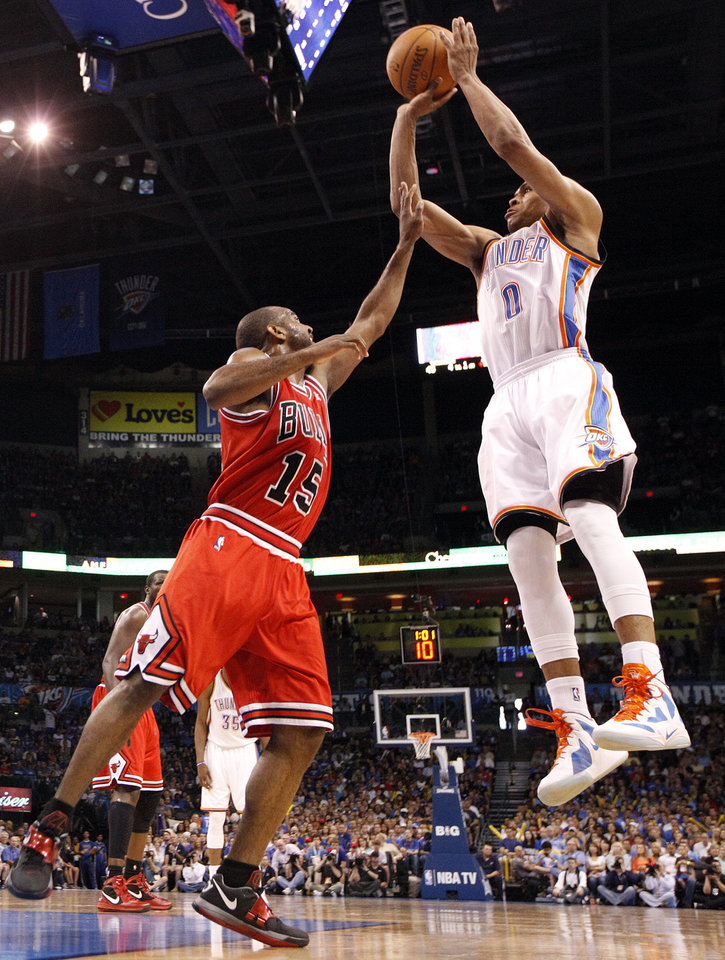 Photo - Oklahoma City's Russell Westbrook (0) shoots over Chicago's John Lucas (15) during the NBA basketball game between the Chicago Bulls and the Oklahoma City Thunder at Chesapeake Energy Arena in Oklahoma City, Sunday, April 1, 2012. Photo by Sarah Phipps, The Oklahoman