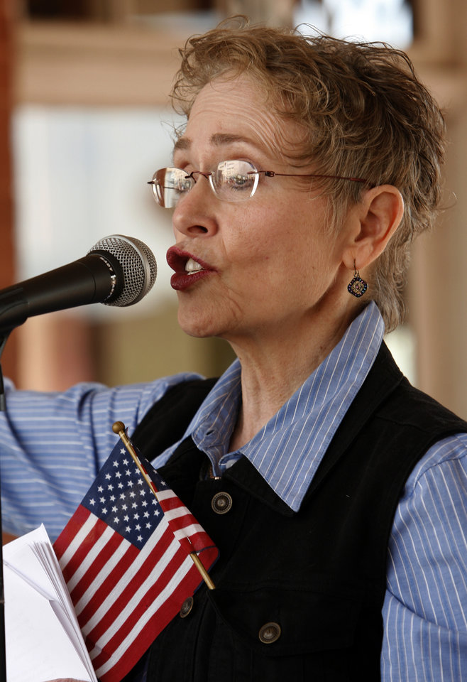 Photo - Mallory Harvey leads as citizens hold a Tax Day Tea Party at the Santa Fe Station in Norman, Okla. on Wednesday, April 15, 2009.  