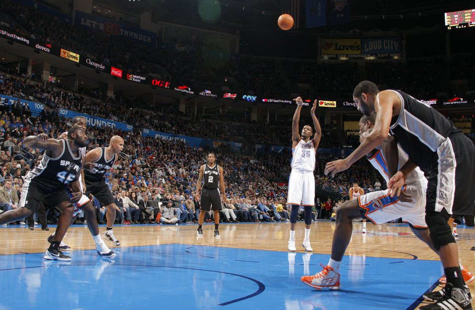 Photo - Oklahoma City Thunder's Kevin Durant (35) shoots a foul during the the NBA basketball game between the Oklahoma City Thunder and the San Antonio Spurs at the Chesapeake Energy Arena in Oklahoma City, Sunday, Jan. 8, 2012. Photo by Sarah Phipps, The Oklahoman