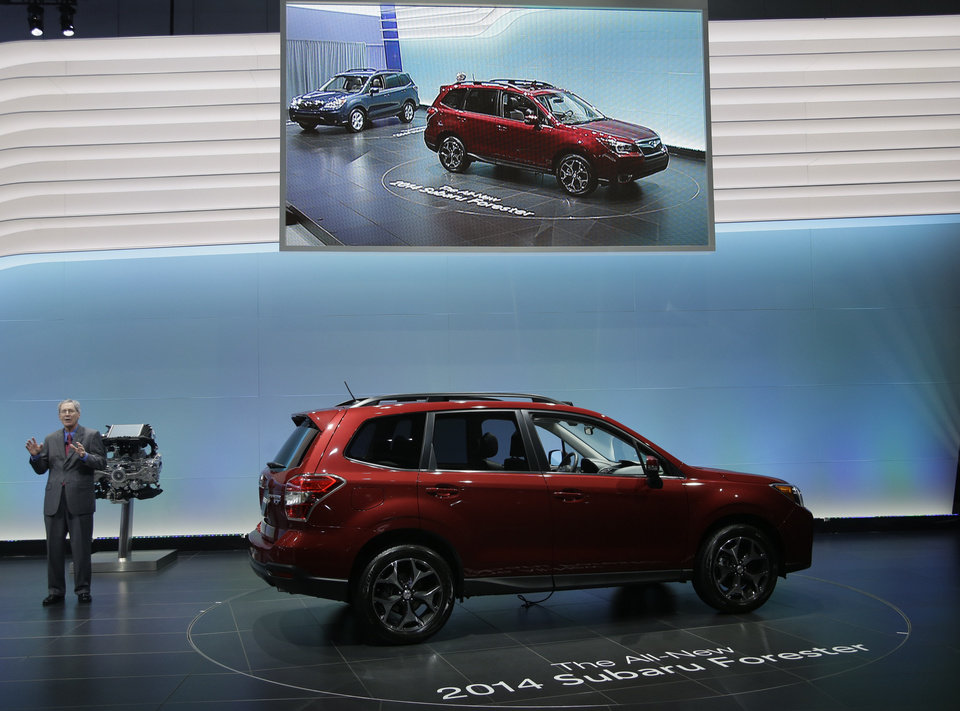 Thomas J. Doll, Executive Vice President, Chief Operating Officer and Chief Financial Officer for Subaru of America, Inc.talks about the 2014 Subaru Forester XT during it\'s world debut at the LA Auto Show in Los Angeles, Wednesday, Nov. 28, 2012. (AP Photo/Chris Carlson)