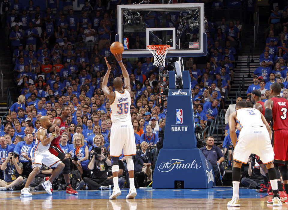 Oklahoma City's Kevin Durant (35) shoots a free-throw during Game 1 of the NBA Finals between the Oklahoma City Thunder and the Miami Heat at Chesapeake Energy Arena in Oklahoma City, Tuesday, June 12, 2012. Photo by Chris Landsberger, The Oklahoman
