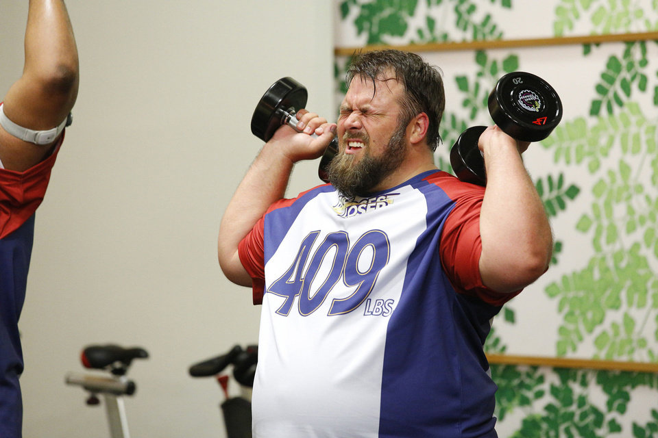 Photo - David Brown lifts weights during